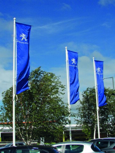 Swivel arm flags on a dealership forecourt